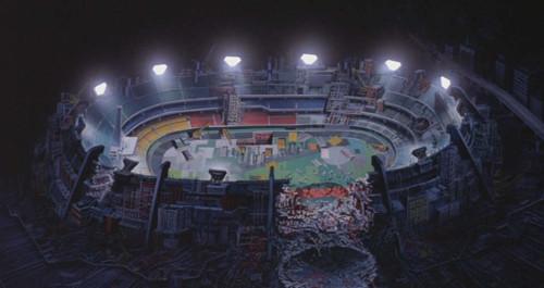 Cena do anime que também mostra o estádio aos escombros.